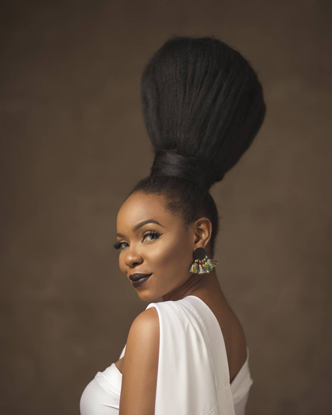 Yemi Alade Broom Hairstyle