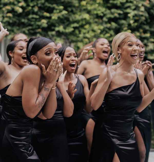 Bride Surprised Bridesmaids With Her Wedding Gown
