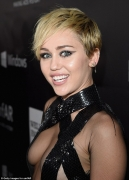 They're almost naked! Miley Cyrus and Rihanna leave little to the imagination in barely-there frocks