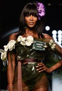 Naomi Campbell flaunts her Amazonian body on Gaultier runway in sheer floral ensemble