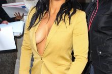 Christiana Milan shows Massive Cleavage in a Mustard-Colored Suit