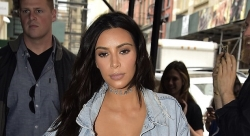 Kim Kardashian Wears A Transparent Bra And A Transparent Plastic Boots At The Same Time