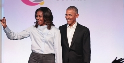 Michelle Obama Looks Amazing In Cowl-Neck Blouse And Plaid Pants