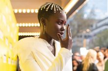 Lupita Nyong'o Wore A Gorgeous White Cut-Out Pantsuit For 'Us' Movie Premiere