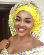 You'd Want To Wear Yellow When You See Mercy Aigbe's Wedding-Guest Dress