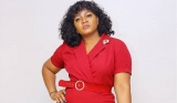 Omotola Jalade Strikes a Pose in Front of Eiffel Towel in a Blue Blazer