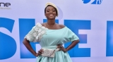 Singer Waje Dressed In A Long Gown, Beret And Fanny Pack To 'She Is' Movie Premiere